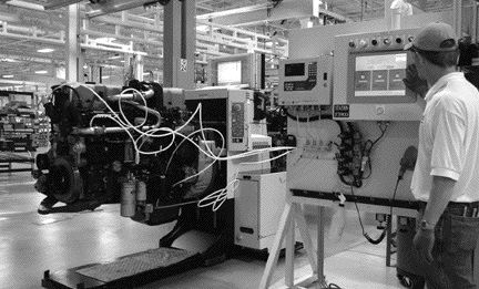 MUCH IMPROVED: An employee at Volvo Powertrain's Hagerstown engine plant performs a leak test on a Mack MP7 engine.