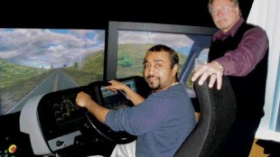 JUST LIKE REAL: Sagar Shetye (left) and Alan Masters of DriveWise demonstrate the realism of today's truck simulators.