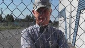 UNIMPRESSED: Ken Bilben looks out from behind the fence of the yard his Kenworth was stolen from. The truck was eventually recovered.