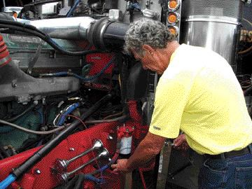 EXCITING EXPERIMENT: Mark Brander of Core Energy installs the Diesel Fuel Exciter on a truck at the Fergus Truck Show.