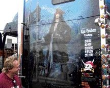 AWE-STRUCK: An onlooker laughs in amazement at the intricate detail found in the truck's murals.