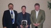 At left, Nevio Turchet of SelecTrucks of Canada presents Dave Waver and Mike Jones of TransX Group of Companies with a retention award.