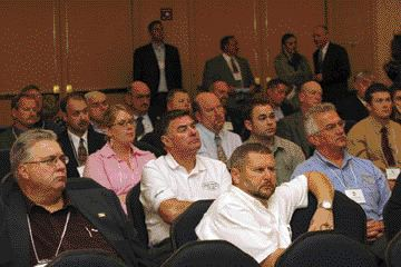 ATTENTIVE AUDIENCE: APTA members listen intently during the association's annual general meeting in October. APTA chairman Vaughn Sturgeon stressed the importance of partnering with government officials and other associations during his address.
