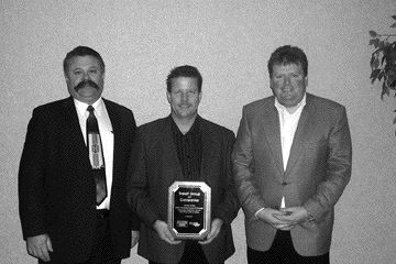 TOPS FOR TRANSX: TransX Group of Companies was awarded the 2006 OTR/SelecTrucks of Canada Canadian Retention Award in the Over 100 Power Units category. Pictured left to right are Nevio Turchet of SelecTrucks, and Dave Waver and Mike Jones of TransX.