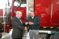 TransX president Louis Tolaini presents the company's longest serving driver Joe Nayanokee with the keys to his new 2007 Peterbilt.