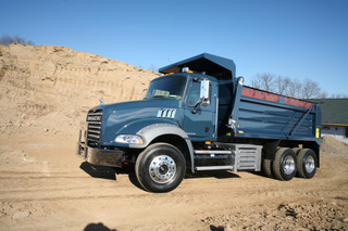This Mack Granite is powered by a hybrid engine that harnesses braking power and uses it to help power the vehicle.