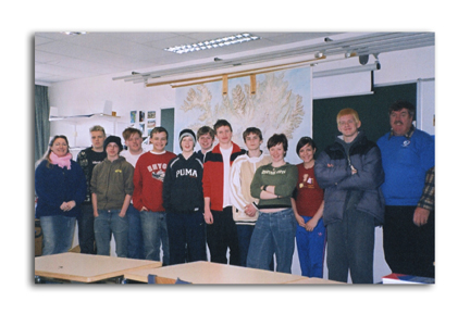 Teacher Sigridur Dua Goldsworthy, far left, and December Trucker Buddy Driver of the Month Bruce Brandon, far right, with the Grade 6 class at Njardvik Elementary School in Iceland.