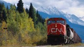 A CN freight train chugs along in a sunny-looking British Columbia, a stark contrast to the province's current harsh winter.