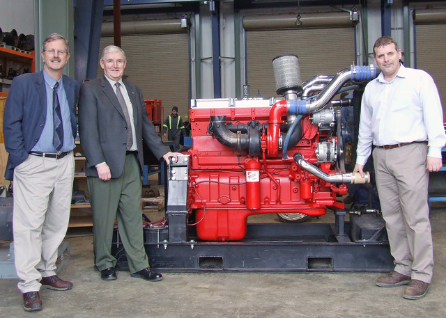 From left, Fred MacDonald, dean of Trades and Applied Technology, Ross Somerville, marketing manager for Cummins Western Canada, and Paul Mottershead, coordinator/instructor, Heavy-Duty Commercial Transport Mechanics program with the latest addition to the program: a Cummins ISX diesel engine.