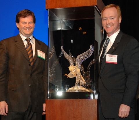 Edmonton Kenworth executives, Collin Ferguson and Gary M. King, with the 2006 Kenworth Dealer of the Year award.