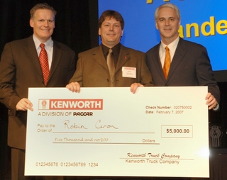 Robin Caron, centre, beat out competitors from across North America to win Kenworth's Medium Duty Walk-Around competition.