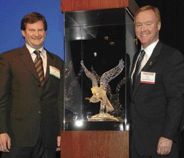 BEST IN NORTH AMERICA: Edmonton Kenworth executives, Collin Ferguson (left) and Gary M. King with the 2006 Kenworth Dealer of the Year award.