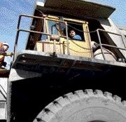 HIGH IN THE SADDLE: Driving the mine trucks can be intimidating at first, due to their size.Photo by Steven Macleod