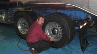 PRESSURE POINTS: LA Dalton fleet manager Mike Henderson adjusts the tire pressure on an X-One super single tire.