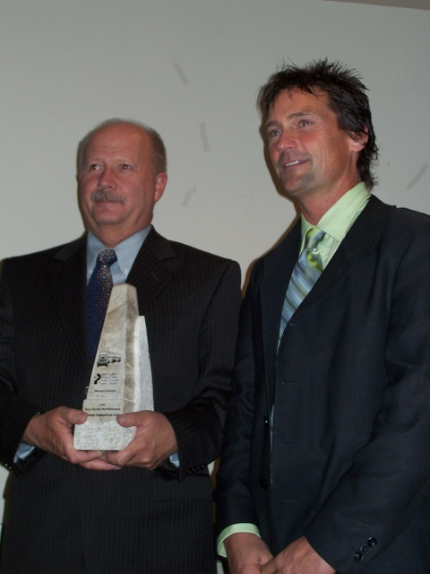 At right Jay Campbell of Scamp Industries accepts the award for Best Overall Carrier from Ted Stoner, vice-president of CPPI.