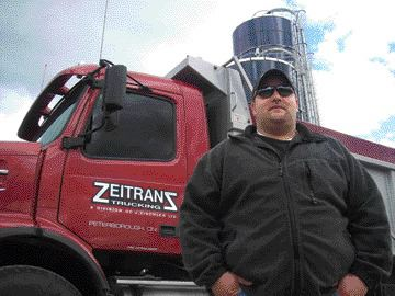 BEST OF BOTH WORLDS: Making the move from farming to trucking was a logical step for Zeitranz Trucking president Juergen Zischler, who has had a love for heavy equipment since childhood.Photo by Adam Ledlow