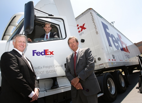 Larry Miller, president and CEO, FedEx Freight East (left), and Doug Duncan, president and CEO, FedEx Freight (right), join Grant Crawford, vice-president/general manager, FedEx Freight Canada (centre), to unveil FedEx Freight Canada's new national headquarters and service centre in Toronto.