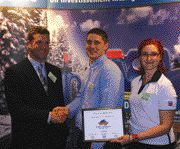 TOP TECHNICIAN: Technician of the Year Calum Robson is flanked by Chevron's Chris Leitch and Ginny Desaulniers.