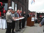 NEW LOOK: Harper Power Products executives cut the ribbon at a revamped company headquarters.