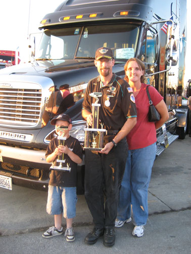 Matthew Slovak stands with his son, Nathan, and his wife, Candice, after winning the second annual Gary King Trucker Buddy trophy.