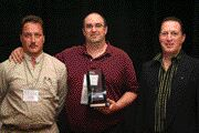 TDL TOPS: Mark Mostacci (left) and Paul Pierce of TDL Group receive their award from David Sheepway of sponsor Zurich.