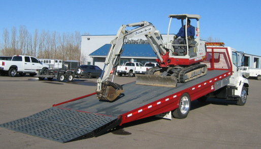 The Jones Body Company tilt and load body allows for the quick and easy loading of heavy equipment.