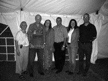 special thanks: Vanderhoeff is flanked by (L-R) Joanne Ritchie, OBAC; Judy Scanlon; Dwight McGill, Goodyear; Evelyn Cartmill, Markel; and John Bennett of Freightliner.