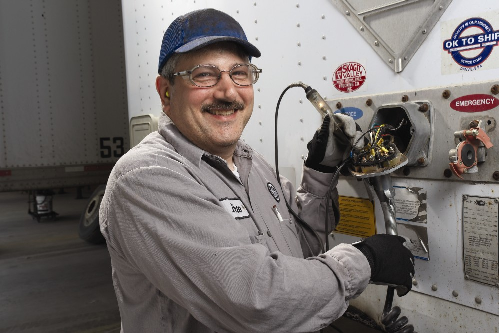 GE Mechanic Peter Metzoian performs a diagnostic check on a trailer, part of routine maintenance performed on both company and customer-owned assets by Trailer Fleet Services.