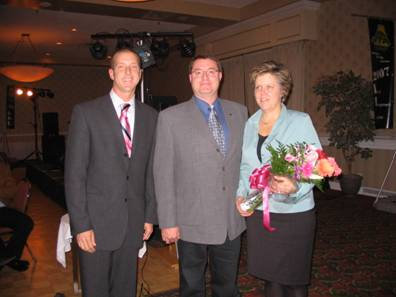 From left to right, Steve Atnikov, Shaw Tracking; Dispatcher of the Year Darren Phillips, Edge Transportation Services; and wife Barb Phillips.