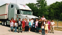 Andrew Pomicter, December's Trucker Buddy of the Month, poses with Christina Demonbreun's elementary school class.