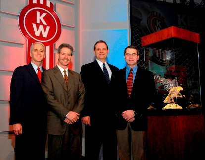 From left are Gary Moore, Kenworth assistant general manager for marketing and sales; Ken Leach, Custom Truck Sales; Bob Christensen, Kenworth general manager; and Brent Leach, Custom Truck Sales.