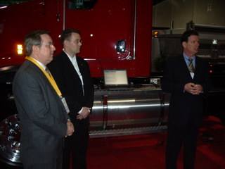 Transport Minister Jim Bradley (left) is pictured with Cummins' Adam Whitney and OTA president David Bradley (right) during a demonstration at Truck World.