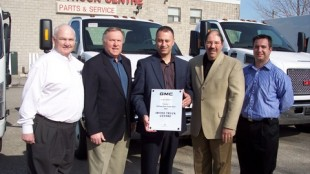 Pictured from left to right are: Frank Gallagher, commercial truck sales manager; Russ White, Irvine truck sales rep; Mike Mintsopoulos, Irvine general manager; Joe Aiello, national manager, GM commercial truck sales and field operations; and Manny Caruso, Irvine new trucks sales manager.
