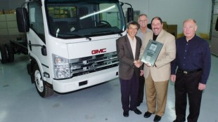 Pictured from left to right are: Bill Sie, dealer principal, Gold Key GMC Commercial Truck Centre, Langley, B.C.; Martin Armstrong, commercial truck sales manager for GM Canada; Joe Aiello, national commercial truck sales manager for GM Canada; and Jim Alden, sales manager west, Isuzu.