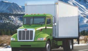 GREENER PASTURES: Peterbilt's Model 330 hybrid will go into full production this summer, the company announced at the Mid-America Trucking Show.