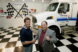 Handing over the keys to the Sterling truck is Brad Davis to Mike Grima. (Photo by David Chidley)