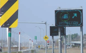 INTELLIGENT BORDER: Electronic signboards inform a driver to report in for inspection.