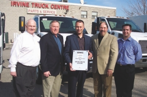 TOPS IN MEDIUM-DUTY SALES: Pictured from left to right are: Frank Gallagher, commercial truck sales manager, Ontario region and Atlantic; Russ White, Irvine truck sales representative; Mike Mintsopoulos, Irvine general manager; Joe Aiello, national manager, GM commercial truck sales and field operations; and Manny Caruso, Irvine new truck sales manager.