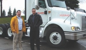 READY TO ROLL: The author, James Menzies (left) and Roadranger's Mike Sharpe get ready to take Purolator's newest truck for a spin along the 401 and Derry Rd. in Mississauga.