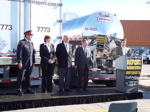 Ontario Trucking Association president David Bradley speaks this morning at the launch of a joint campaign to catch aggressive drivers on the highway. Pictured left to right: Deputy Chief Chuck Mercier, OPP Commissioner Julian Fantino, Debbie Virgoe, and Transport Minister Jim Bradley.