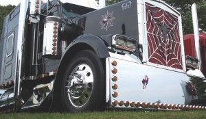 WEB-SLINGING WONDER: This spider-themed rig, owned by Vic Pannu of Pannu Transport (Diesel Truck Centre), doesn't really show its stuff until you turn the lights out. The truck's light show was good enough to take home second place in the Best Light Show Single category of the show n' shine.