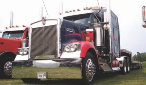 COOL KENWORTH: Tom Ellis's cool red and blue Kenworth was a winner twice over in the show'n'shine competition, taking first place in the Best Tractor/Trailer -Tandem -Float, Flat or Curtain-side category and second place in the Best '00 to '03 O/O Working Tractor category .