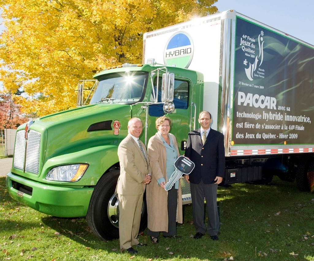 From left, Kelly Kennedy, Kenworth Canadian sales director; Ste. Therese Mayor Sylvie Surprenant; and Chakib Toubal Seghir, PACCAR Ste. Therese plant manager.