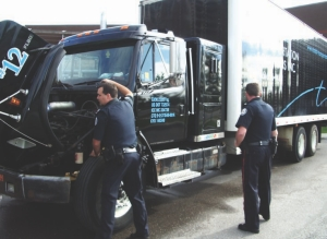HIDE AND SEEK: Sgt. Rob Whalen hides fake contraband on this Total Transportation Solutions truck as part of a training exercise.