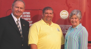 INDUSTRY PRIDE: Road Knight Doug Ladds (centre) has spread the road safety message far and wide, including to politicians such as MPP Monte Kwinter (left) and former Transport Minister Donna Cansfield (right).