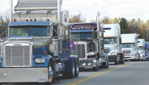 GIRL POWER: The convoy sets out en-route to a celebration at the 730 Truck Stop in Cardinal, Ont.