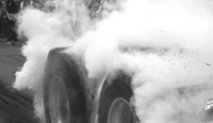 LIGHT'EM UP: A trucker burns some rubber and sacrifices a set of tires in the name of speed. This year's event will pit Canadian truckers against Americans, organizers claim.