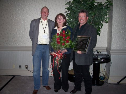 AMTA Driver of the Year Pat Thorne (right) and his wife Cheryl receive the award from Terry Warkentin, fleet sales manager, Volvo Trucks Western Canada.
