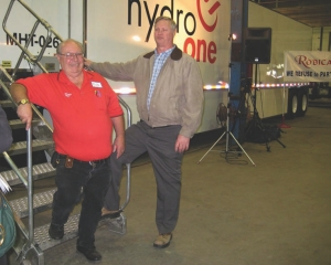 CUSTOM FIT: Bob Nothof, vice-president and general manager of Robica (left) presents Don Comeau of Hydro One with the first of six Mammoth TOT trailers.