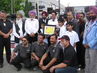 Dara Nagra receives the Entrepreneur of the Year award at the Road Today Truck Show.